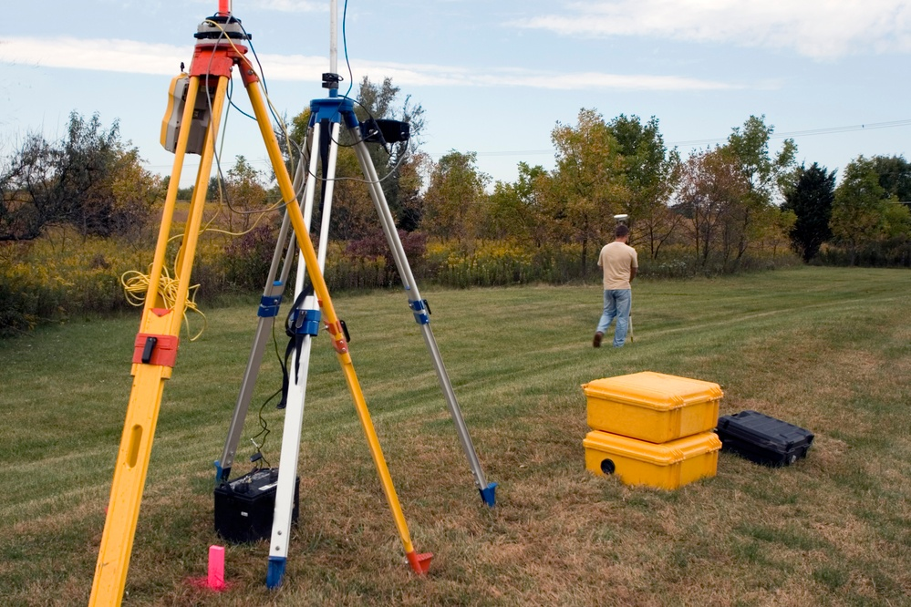 surveyor measuring land creating a plat map
